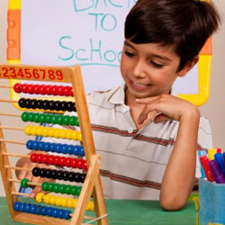 boy looking at abacus